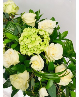 Casket cushion with white roses