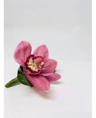 An exotic pink boutonniere
