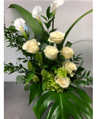 Basket of flowers with white roses
