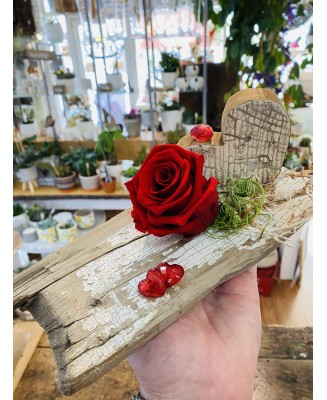 Eternal rose montage with wooden heart